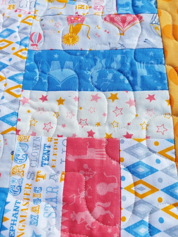 Handmade quilt Circus rail fence design close-up front