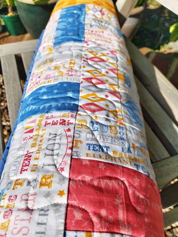 Handmade quilt Circus rail fence rolled close-up