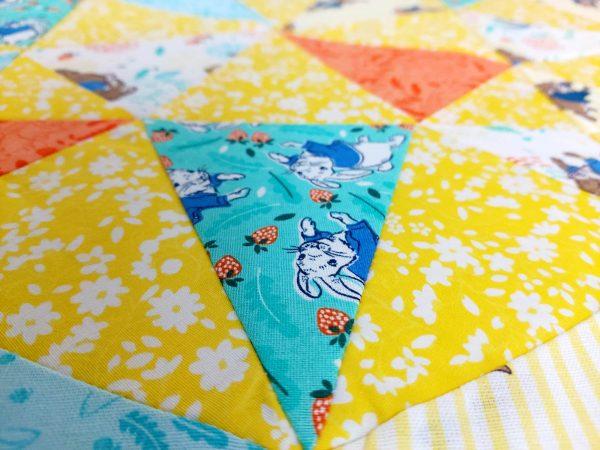 Handmade quilt Peter Rabbit kaleidoscope design close-up front