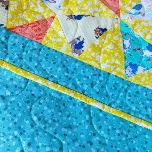 Handmade quilt Peter Rabbit kaleidoscope design close-up