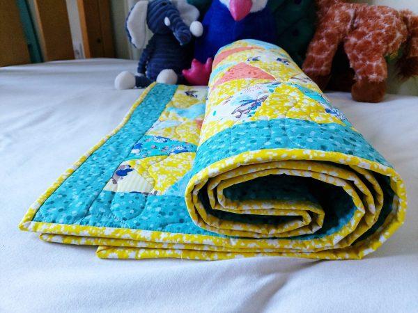 Handmade quilt Peter Rabbit kaleidoscope rolled full