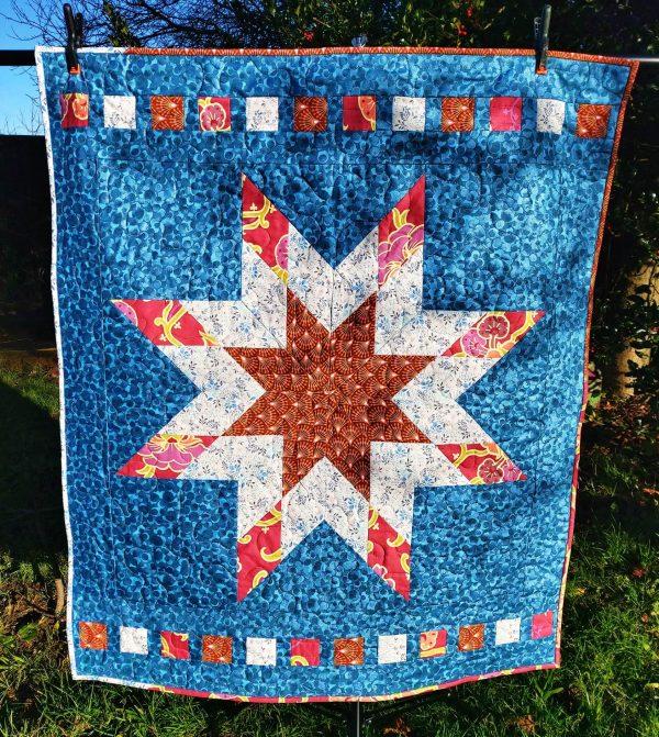 Handmade quilt Little star blue cot quilt design full front