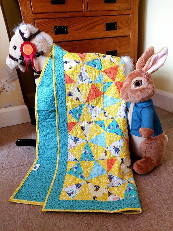 Handmade quilt Peter Rabbit kaleidoscope styled scene