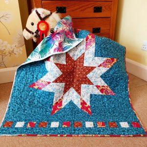 Handmade quilt Little star blue cot quilt