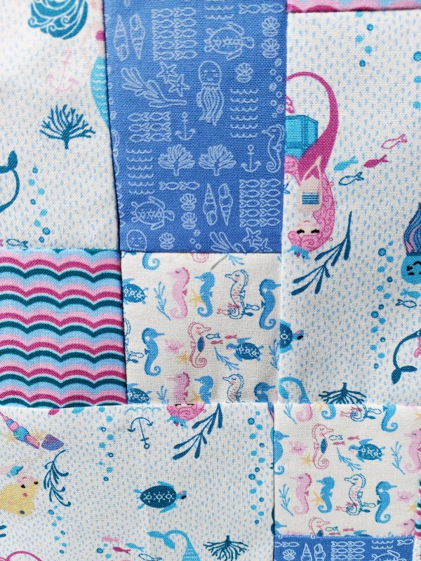 Handmade quilt Disappearing mermaids 'Nearly there' range pattern close-up front